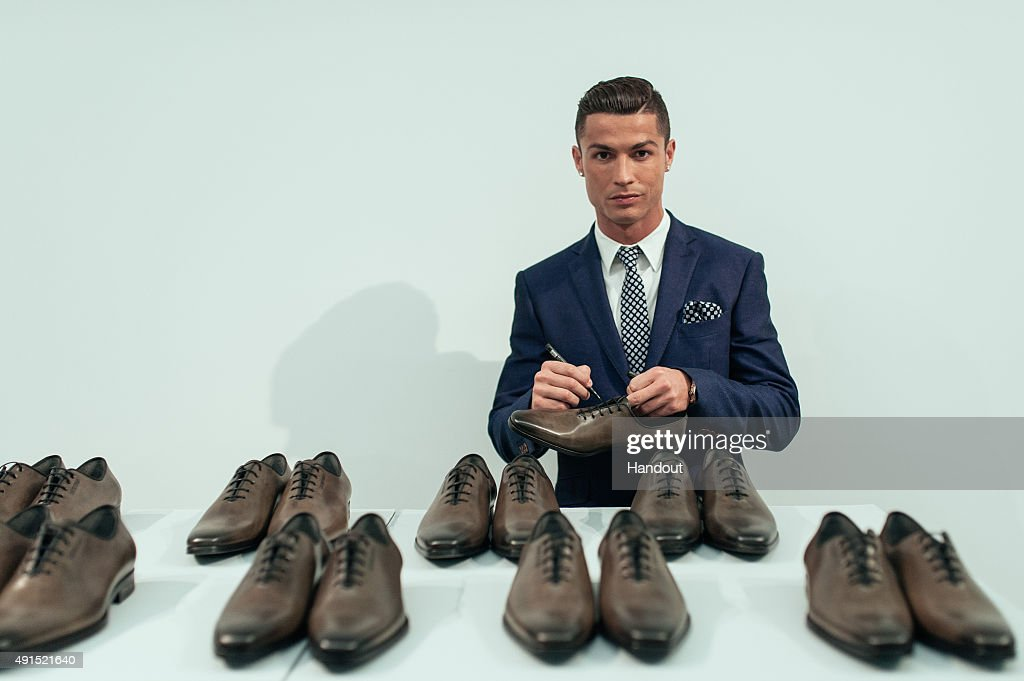 <a gi-track='captionPersonalityLinkClicked' href=/galleries/search?phrase=Cristiano+Ronaldo+-+Voetballer&family=editorial&specificpeople=162689 ng-click='$event.stopPropagation()'>Cristiano Ronaldo</a> signs 10 pairs of CR7 Footwear during the global launch of his FW15 collection. Each pair will be put in to circulation to be purchased at random by lucky consumers around the world on October 5, 2015 in Guimaraes, Portugal.