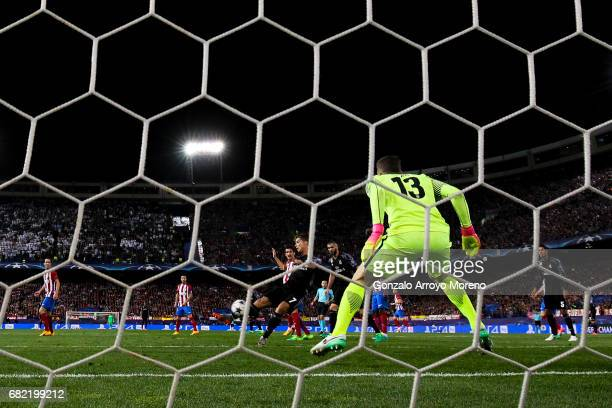 Cristiano Ronaldo strikes the ball behind goalkeeper Jan Oblak of Atletico de Madrid during the UEFA Champions League Semi Final second leg match...