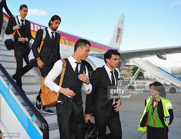 Cristiano Ronaldo talks with Pepe of Real Madrid as the players and officials of Real Madrid arrive at Lisbon airport prior to the UEFA Champions...