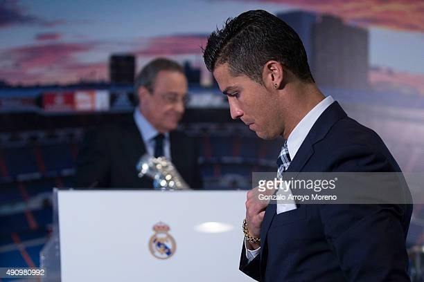 Cristiano Ronaldo walks to the tribune ahead president Florentino Perez before receiving his trophy as alltime top scorer of Real Madrid CF at Honour...
