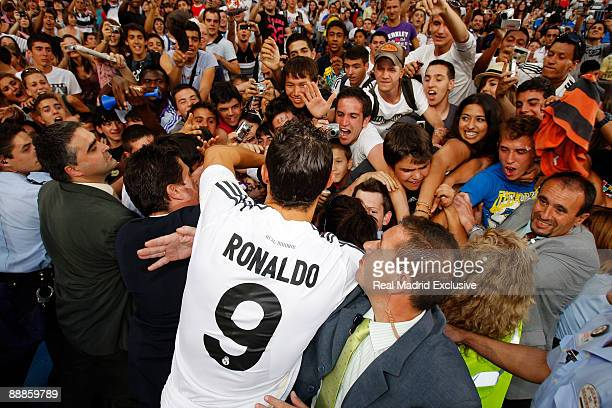 Cristiano Ronaldo waves to fans during his official presentation as new Real Madrid Player at the Santiago Bernabeu Stadium on July 6 2009 in Madrid...