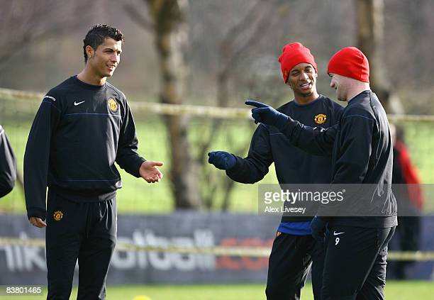 Cristiano Ronaldo Wayne Rooney and Nani of Manchester United share a joke during a Manchester United training session held at the Carrington Training...