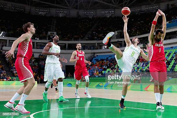 Cristiano Silva Felicio of Brazil drives to the basket against Krunoslav Simon of Croatia during the Men's Basketball Preliminary Round Group B...