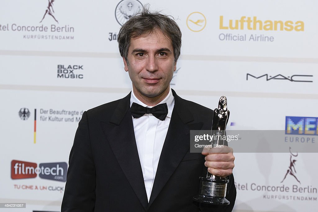 Cristiano Travaglioli poses with his award for European Cut 2013 at the European Film Awards 2013 on December 7, 2013 in Berlin, Germany.