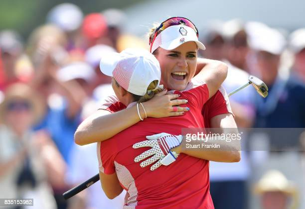 Cristie Kerr and Lexi Thompson of Team USA celebrate halving their match during the morning foursomes matches of The Solheim Cup at Des Moines Golf...