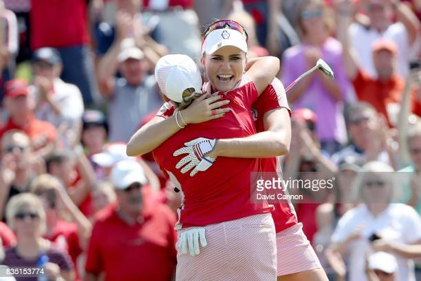 Cristie Kerr and Lexi Thompson of the United States Team Team celebrate after securing a half point on the 18th hole in their match against Charley...