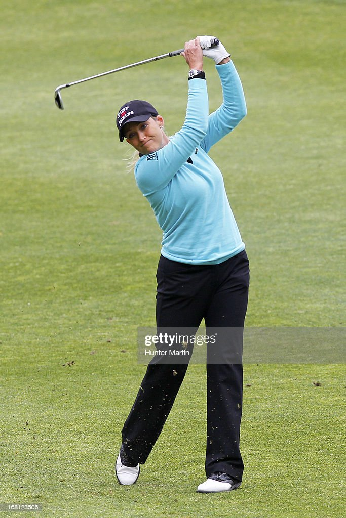 <a gi-track='captionPersonalityLinkClicked' href=/galleries/search?phrase=Cristie+Kerr&family=editorial&specificpeople=213495 ng-click='$event.stopPropagation()'>Cristie Kerr</a> hits her second shot on the eighth hole during the final round of the Kingsmill Championship at Kingsmill Resort on May 5, 2013 in Williamsburg, Virginia.