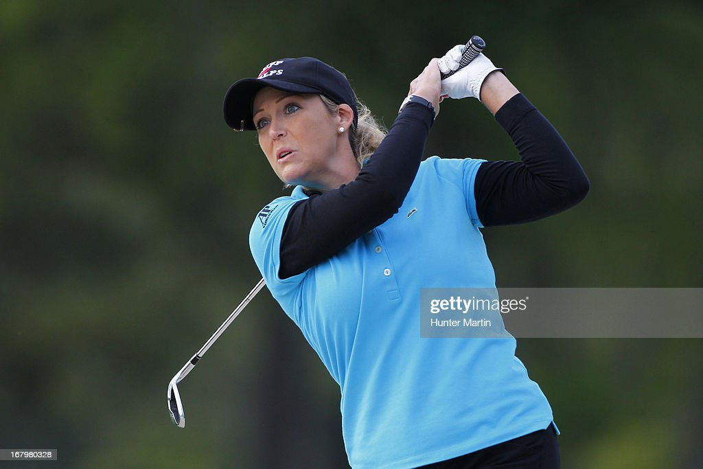 <a gi-track='captionPersonalityLinkClicked' href=/galleries/search?phrase=Cristie+Kerr&family=editorial&specificpeople=213495 ng-click='$event.stopPropagation()'>Cristie Kerr</a> hits her second shot on the ninth hole during the second round of the Kingsmill Championship at Kingsmill Resort on May 3, 2013 in Williamsburg, Virginia.
