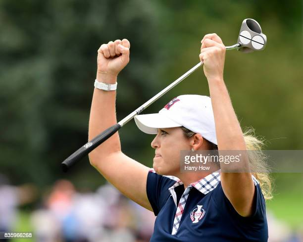 Cristie Kerr of Team USA celebrate her putt to beat Melissa Reid of Team Europe two and one during the final day singles matches of the Solheim Cup...