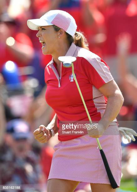 Cristie Kerr of Team USA celebrates halving their match during the morning foursomes matches of The Solheim Cup at Des Moines Golf and Country Club...