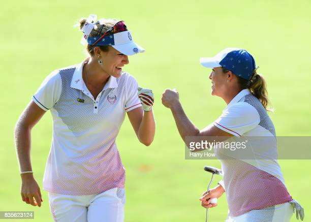 Cristie Kerr of Team USA celebrates her birdie putt with Lexi Thompson to halve the 12th hole with Team Europe during the evening fourball matches of...
