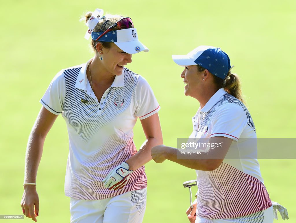 Cristie Kerr of Team USA celebrates her birdie putt with Lexi Thompson to halve the 12th hole with Team Europe during the evening four-ball matches of the Solheim Cup at the Des Moines Golf and Country Club on August 19, 2017 in West Des Moines, Iowa.