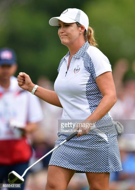 Cristie Kerr of Team USA celebrates holeing the winning putt during the second day morning foursomes matches of The Solheim Cup at Des Moines Golf...