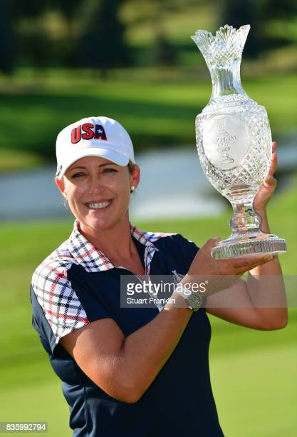Cristie Kerr of Team USA holds the Solheim Cup trophy after the final day singles matches of The Solheim Cup at Des Moines Golf and Country Club on...