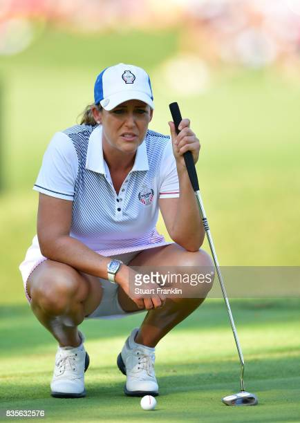 Cristie Kerr of Team USA lines up a putt during the second day afternoon fourball matches of The Solheim Cup at Des Moines Golf and Country Club on...