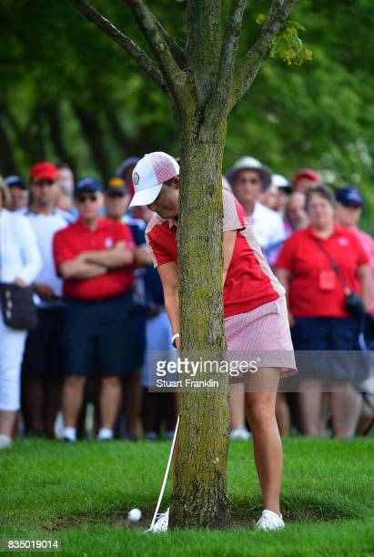 Cristie Kerr of Team USA plays a shot behind a tree on the fifth hole during the morning foursomes matches of The Solheim Cup at Des Moines Golf and...