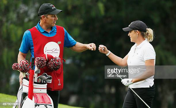 Cristie Kerr of the United States celebrates with her caddie Greg Johnston after making eagle on the 17th hole during the final round of the Lorena...