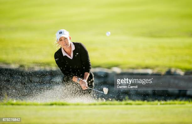 Cristie Kerr of the United States plays a bunker shot at the 18th hole during a final round playoff at the Volunteers of America North Texas Shootout...