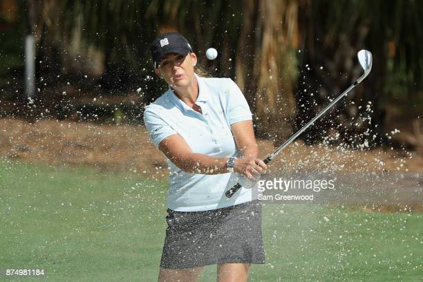 Cristie Kerr of the United States plays a shot from a bunker on the sixth hole during round one of the CME Group Tour Championship at the Tiburon...