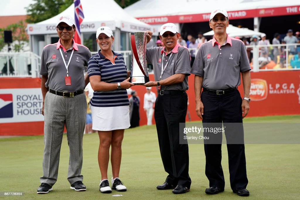 Cristie Kerr of the United States poses with Tun Dato' Musa Hitam ( 2nd from right ) and members of the Club's VVIP during the presentation ceremony during day four of the Sime Darby LPGA Malaysia at TPC Kuala Lumpur East Course on October 29, 2017 in Kuala Lumpur, Malaysia.