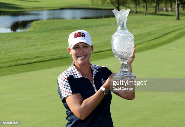 Cristie Kerr of the United States Team holds the Solheim Cup after the closing ceremony during the final day singles matches in the 2017 Solheim Cup...