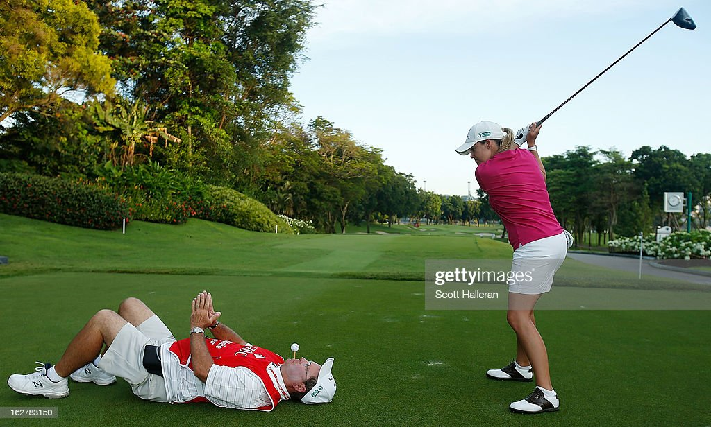 Cristie Kerr of the USA prepares to hit a shot from an unusual lie during the pro-am prior to the start of the HSBC Women's Champions at the Sentosa Golf Club on February 27, 2013 in Singapore, Singapore.