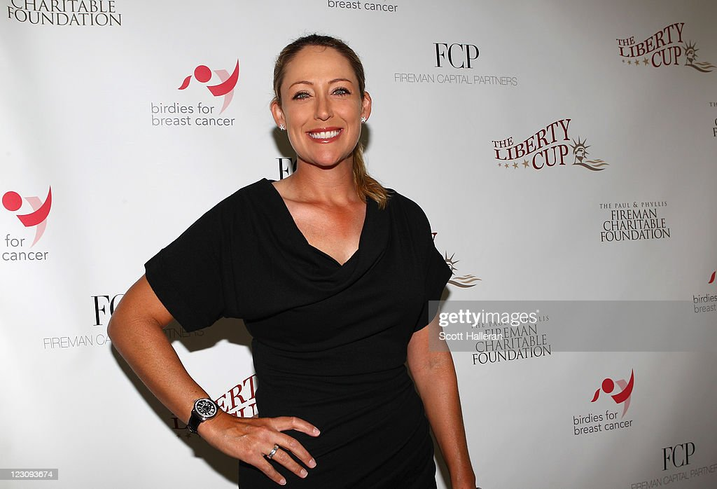 <a gi-track='captionPersonalityLinkClicked' href=/galleries/search?phrase=Cristie+Kerr&family=editorial&specificpeople=213495 ng-click='$event.stopPropagation()'>Cristie Kerr</a> poses for a photo after the Birdies for Breast Cancer Foundation Liberty Cup at Liberty National Golf Club on August 30, 2011 in Jersey City, New Jersey.