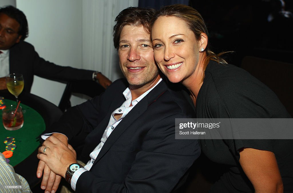 Cristie Kerr (R) poses with her husband Erik Stevens after the Birdies for Breast Cancer Foundation Liberty Cup at Liberty National Golf Club on August 30, 2011 in Jersey City, New Jersey.
