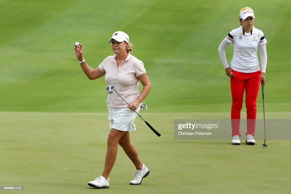 Cristie Kerr reacts to a par putt on the ninth green, alongside Su-Yeon Jang of Republic of Korea, during the final round of the LPGA LOTTE Championship Presented By Hershey at Ko Olina Golf Club on April 15, 2017 in Kapolei, Hawaii.