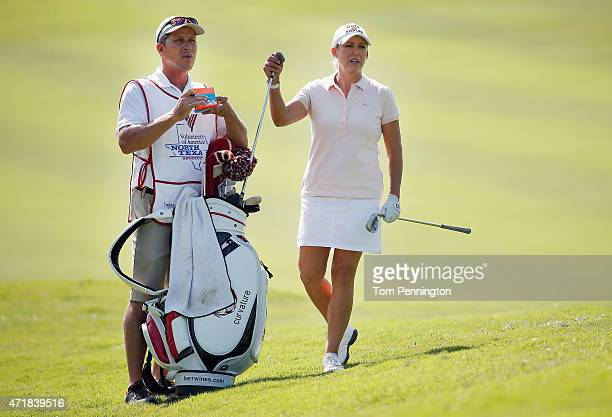 Cristie Kerr selects a club on the ninth hole during Round Two of the 2015 Volunteers of America North Texas Shootout Presented by JTBC at Las...