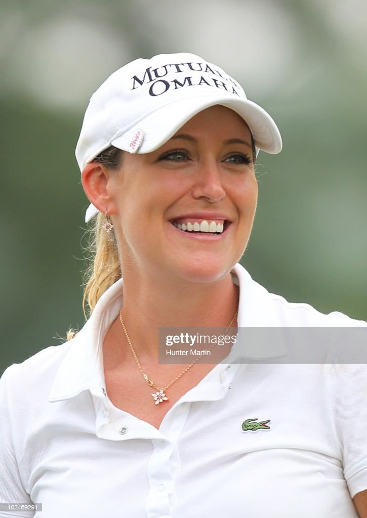 Cristie Kerr smiles on the 18th green after winning the LPGA Championship presented by Wegmans at Locust Hill Country Club on June 27, 2010 in Pittsford, New York.