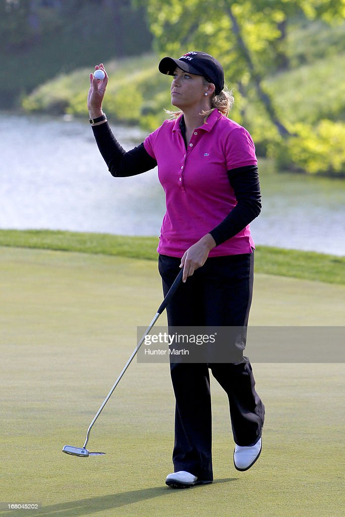 <a gi-track='captionPersonalityLinkClicked' href=/galleries/search?phrase=Cristie+Kerr&family=editorial&specificpeople=213495 ng-click='$event.stopPropagation()'>Cristie Kerr</a> waves to the crowd after finishing her round on the 18th hole during the third round of the Kingsmill Championship at Kingsmill Resort on May 4, 2013 in Williamsburg, Virginia.