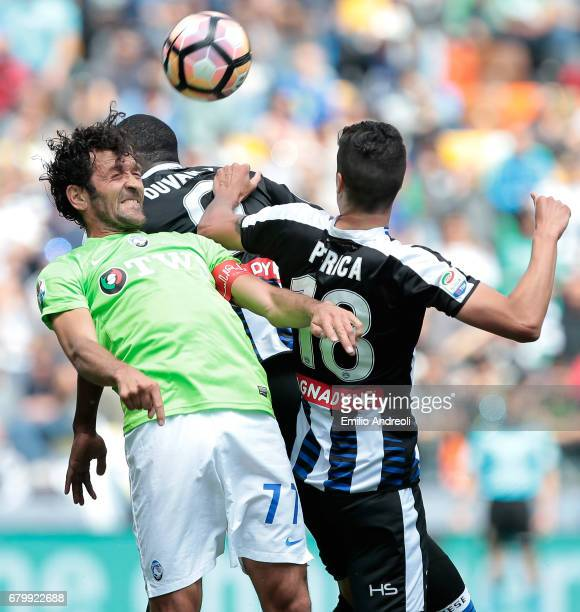 Cristin Raimondi of Atalanta BC jumps for the ball with Stipe Perica of Udinese Calcio during the Serie A match between Udinese Calcio and Atalanta...