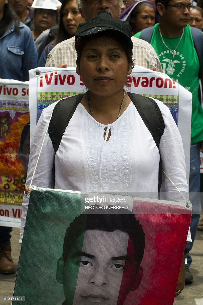 Cristina Bautista, mother of Benjamin Ascencio, one of the 43 missing students of Ayotzinapa, participates in a demo in support of the National Coordination of Education Workers (CNTE) teachers' union, and against an education reform launched by the government along Reforma Avenue in Mexico City on June 26, 2016. / AFP / Hector GUERRERO