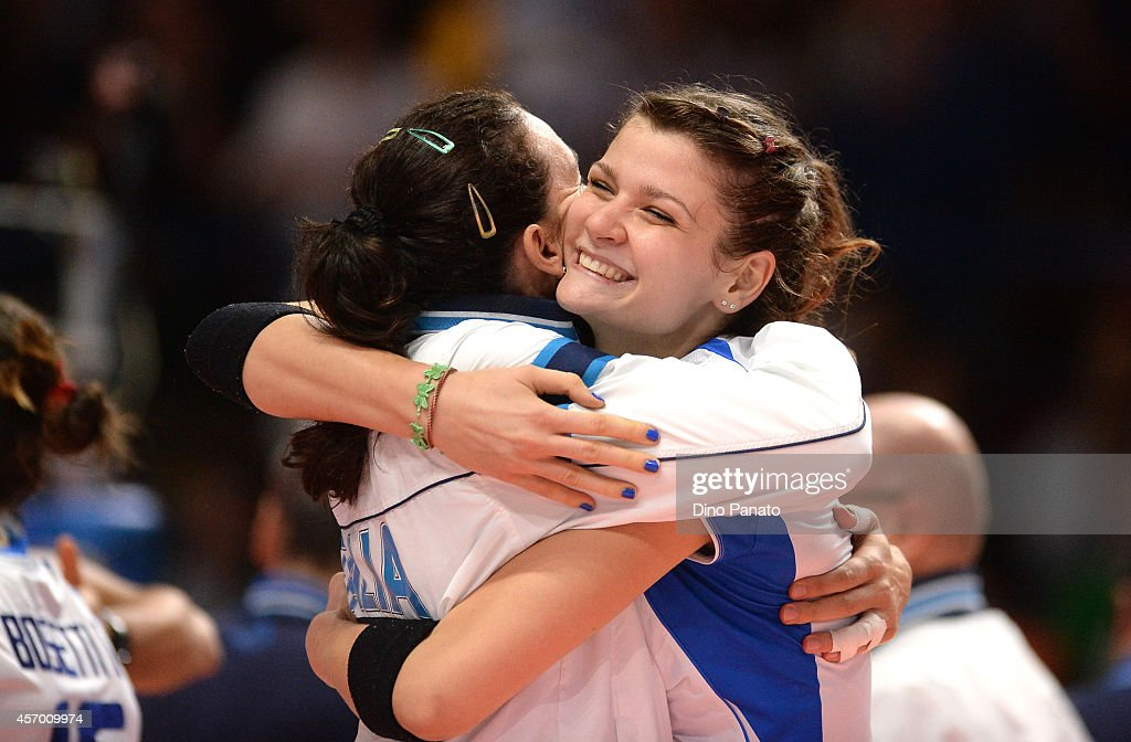Cristina Chirichella (R) of Italy celebrates victory with <a gi-track='captionPersonalityLinkClicked' href=/galleries/search?phrase=Nadia+Centoni&family=editorial&specificpeople=2309657 ng-click='$event.stopPropagation()'>Nadia Centoni</a> after the FIVB Women's World Championship pool H match between Italy and Russia on October 10, 2014 in Milan, Italy.