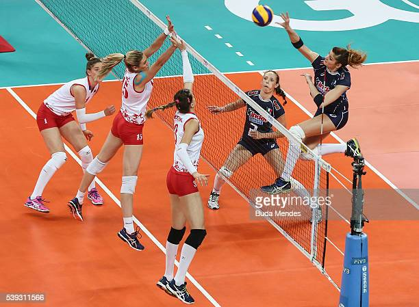 Cristina Chirichella of Italy spikes the ball as Jovana Stevanovic and Sanja Malagurski of Serbia defend during the match between Italy and Serbia on...