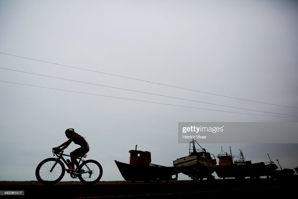 Cristina Farez of Ecuador competes in cycling during Triathlon by teams event as part of the XVII Bolivarian Games Trujillo 2013 at Salaverry Port on November 27, 2013 in Trujillo, Peru.