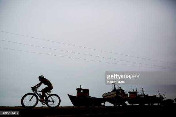 Cristina Farez of Ecuador competes in cycling during Triathlon by teams event as part of the XVII Bolivarian Games Trujillo 2013 at Salaverry Port on...