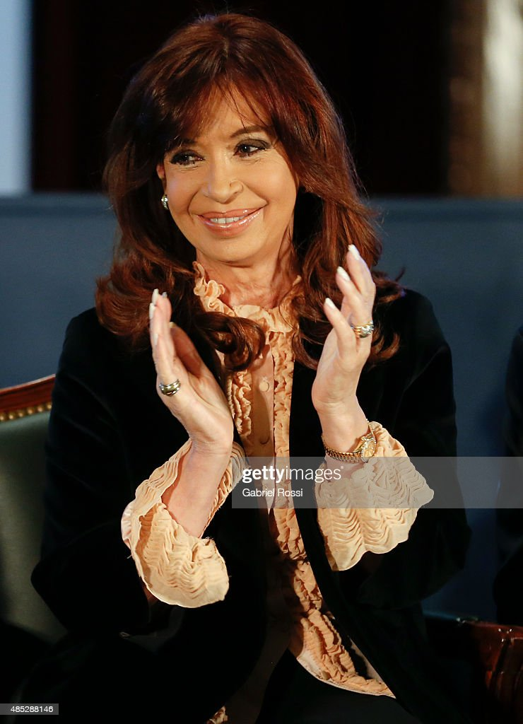 <a gi-track='captionPersonalityLinkClicked' href=/galleries/search?phrase=Cristina+Fernandez+de+Kirchner&family=editorial&specificpeople=565499 ng-click='$event.stopPropagation()'>Cristina Fernandez de Kirchner</a> President of Argentina claps during a ceremony commemorating the 161st anniversary of the Buenos Aires Stock Exchange on August 26, 2015 in Buenos Aires, Argentina.