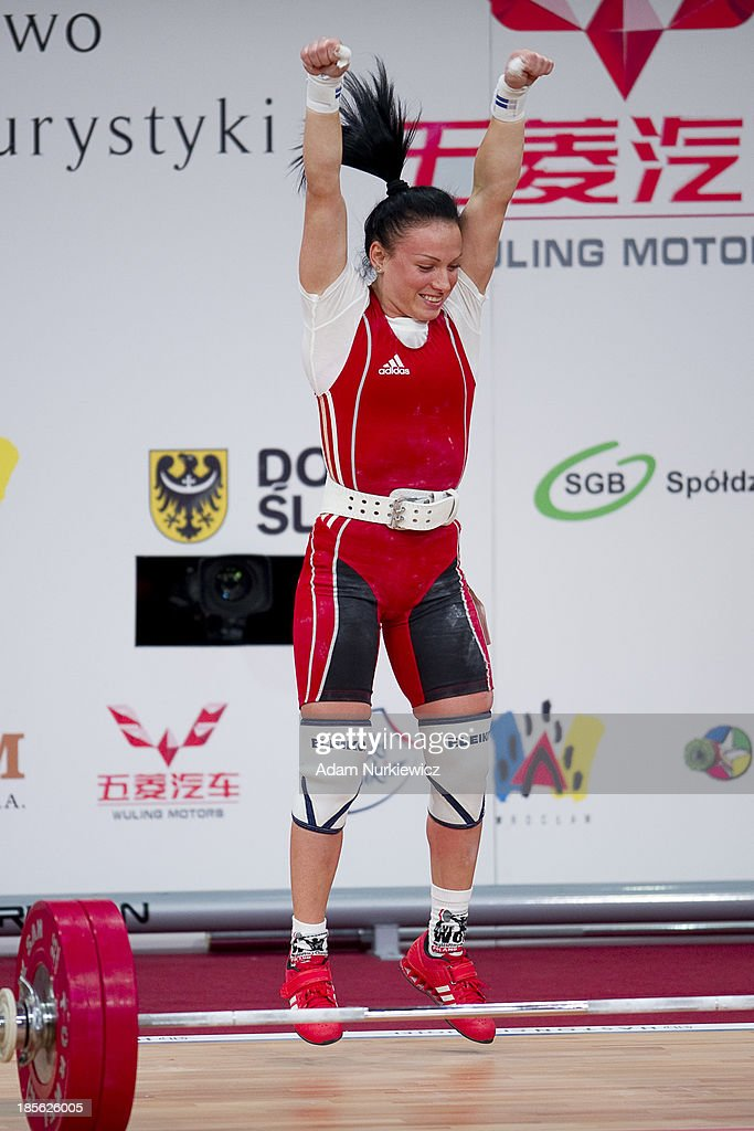 Cristina Iovu from Azerbaijan lifts in the Clean and Jerk competition during the women's 53 kg Group A weightlifting IWF World Championships Wroclaw 2013 at Centennial Hall on October 21, 2013 in Wroclaw, Poland.