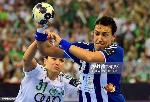 Cristina Neagu of Montenegrian Podgorica fights for the ball with Yvette Broch of Gyori Audi during the EHF Women's Champions League Final Four...