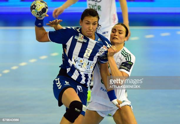 Cristina Neagu of Montenegrian Podgorica fights for the ball with Yvette Broch of Gyori during the EHF Women's Champions League Final Four semifinal...