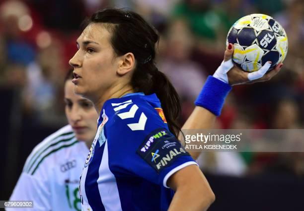 Cristina Neagu of Montenegrian Podgorica scores a goal against Eduarda Amorim of Gyor during the EHF Women's Champions League Final Four semifinal...