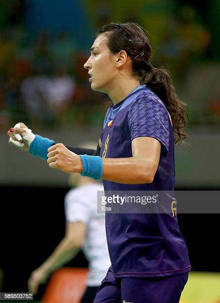 Cristina Neagu of Romania celebrates in the first half against Norway on Day 9 of the Rio 2016 Olympic Games at the Future Arena on August 14 2016 in...