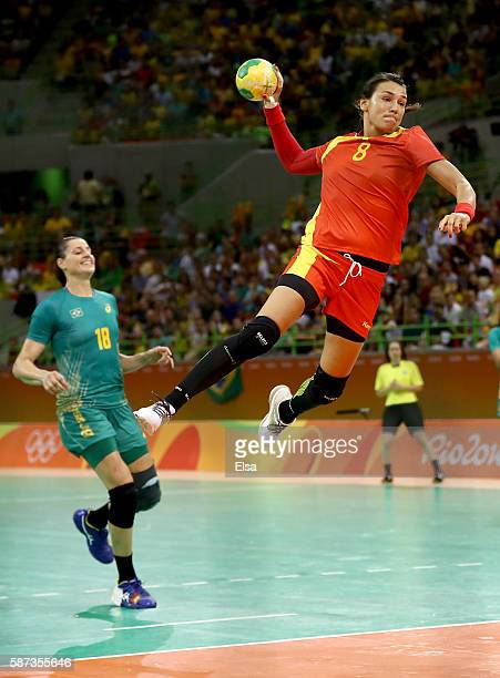 Cristina Neagu of Romania takes a shot as Eduarda Taleska of Brazil defends on Day 3 of the Rio 2016 Olympic Games at the Future Arena on August 8...
