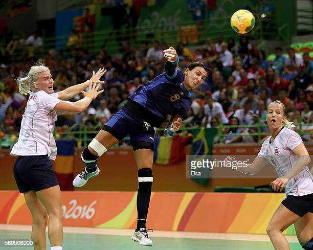 Cristina Neagu of Romania takes a shot as Veronica Kristiansen and Heidi Loke of Norway defend on Day 9 of the Rio 2016 Olympic Games at the Future...