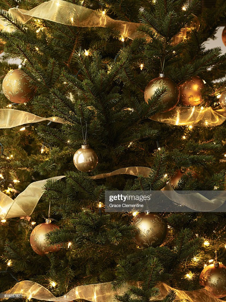 Cristmas tree with golden ornaments closeup : Stock Photo