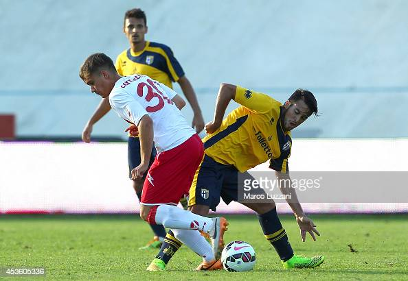 Cristobal Djorquera of FC Parma competes for the ball with Nicola Cornacchia of AS Varese during the preseason friendly match between AS Varese and...