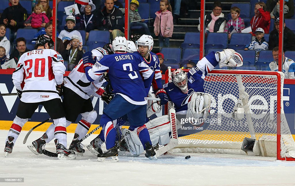 Cristobal Huet (C),goaltender of France covers the puck during the IIHF World Championship group H match between France and Austria at Hartwall Areena on May 5, 2013 in Helsinki, Finland.
