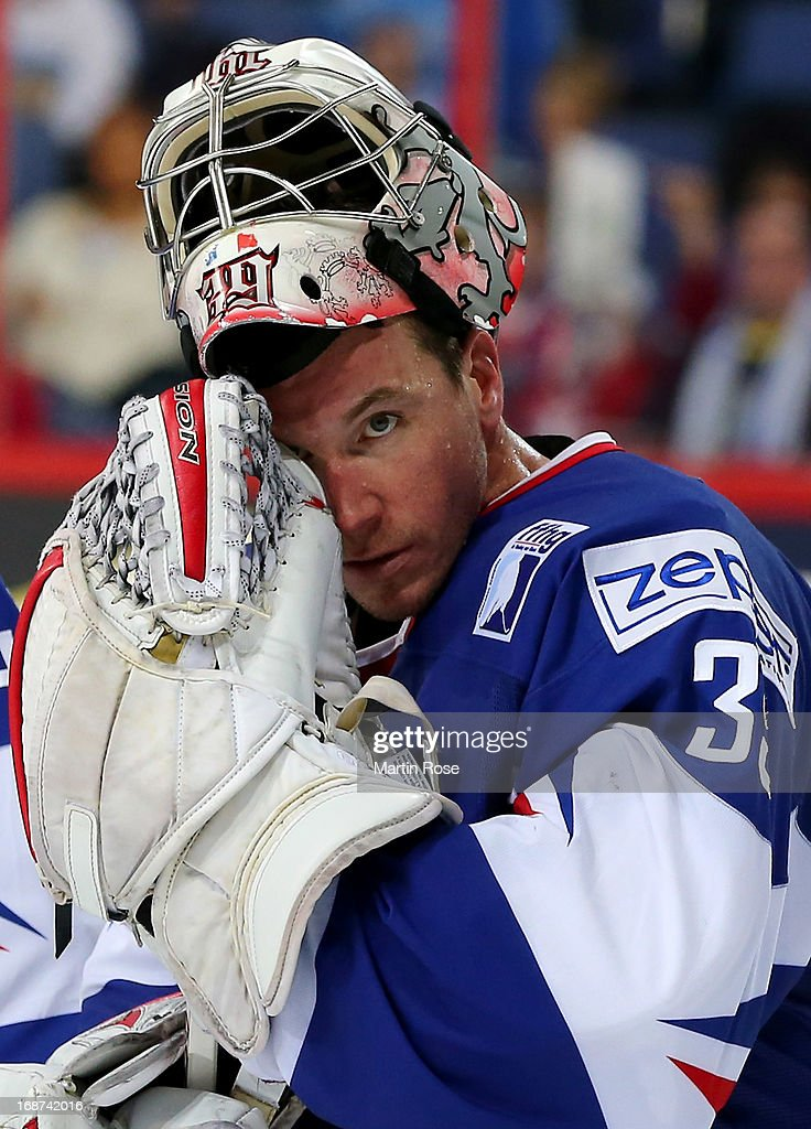 <a gi-track='captionPersonalityLinkClicked' href=/galleries/search?phrase=Cristobal+Huet&family=editorial&specificpeople=202923 ng-click='$event.stopPropagation()'>Cristobal Huet</a>, goaltender of France looks dejected after the IIHF World Championship group H match between France and Germany at Hartwall Areena on May 14, 2013 in Helsinki, Finland.
